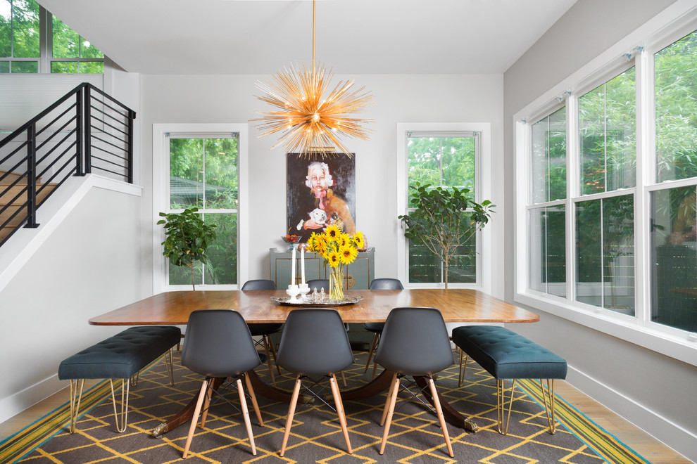 Inspiration for a transitional light wood floor dining room remodel in Austin with gray walls