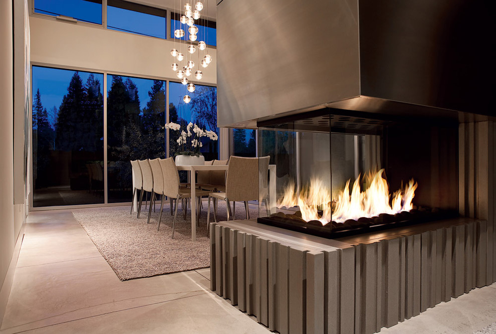 Trendy beige floor dining room photo in San Francisco with a two-sided fireplace