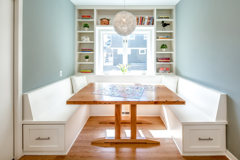 Dining room - transitional medium tone wood floor dining room idea in Minneapolis with blue walls and no fireplace