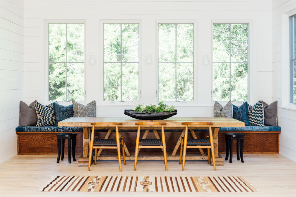 Example of a danish light wood floor and beige floor dining room design in Charleston with white walls and no fireplace
