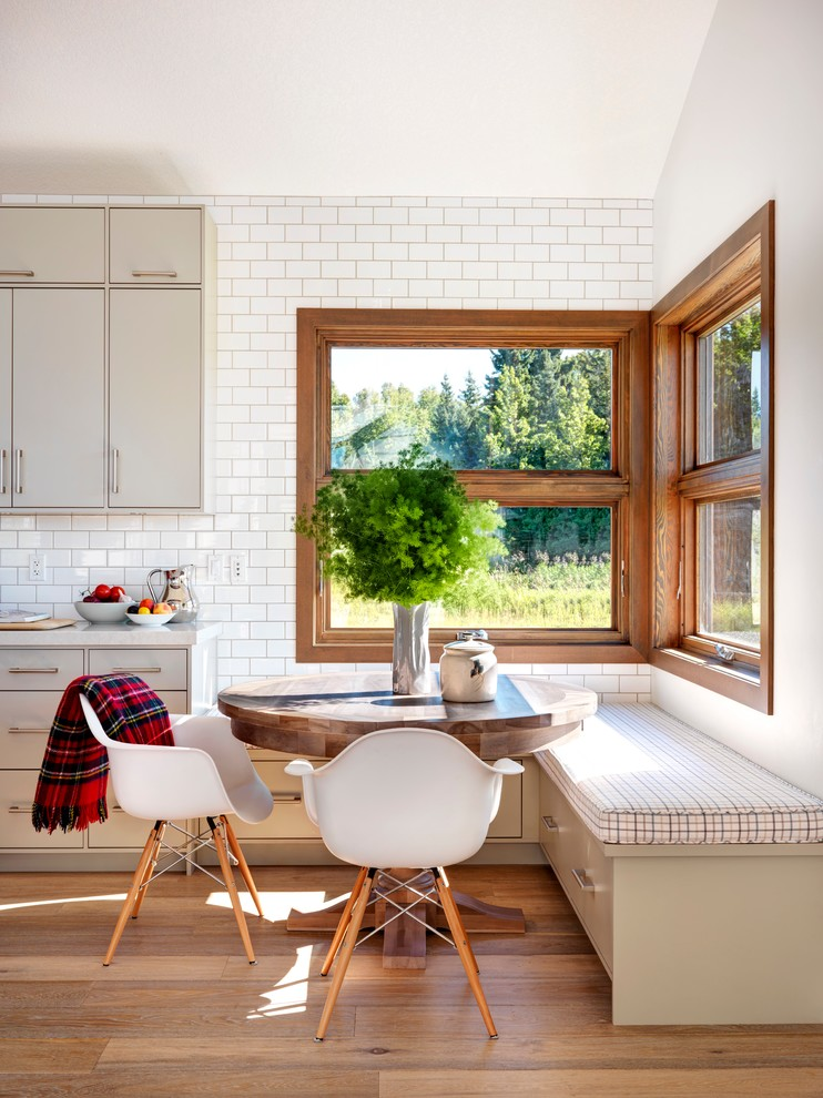 Inspiration for a huge country medium tone wood floor kitchen/dining room combo remodel in Calgary