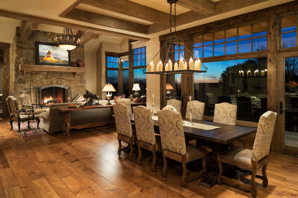 Example of a huge mountain style medium tone wood floor great room design in Minneapolis with beige walls