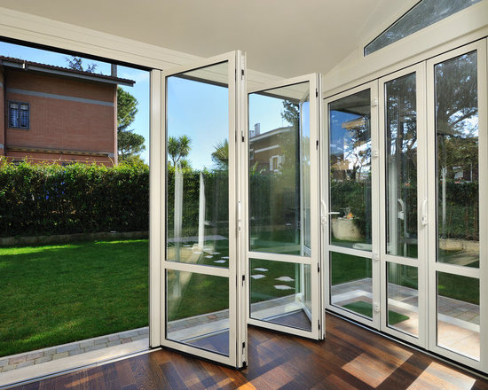 Residence in Canada - Panda Windows & Doors - For astounding outdoor views, even in cold climates, the Thermally Broken Bi-Folding Door System is a perfect choice. This private residence in Canada utilizes these Panda doors for maximum natural light and warmth even when snow is falling.