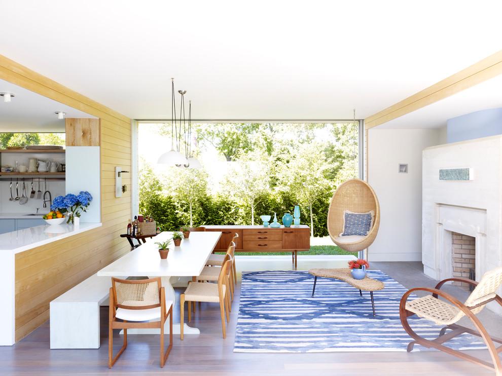 Réalisation d'une salle à manger ouverte sur le salon design de taille moyenne avec une cheminée standard.