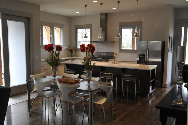 Modern vs traditional dining room with view of kitchen for Dining room vs living room