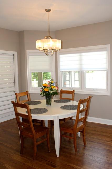 Large minimalist medium tone wood floor kitchen/dining room combo photo in Cincinnati with beige walls and no fireplace