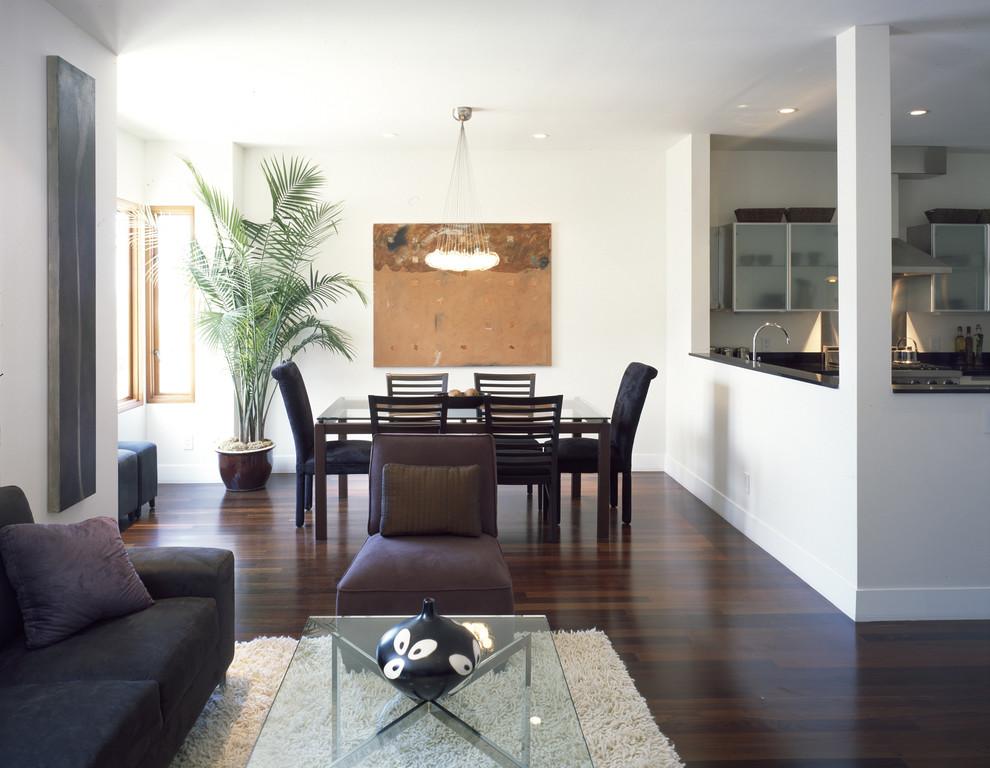 Trendy dark wood floor and brown floor great room photo in San Francisco with white walls