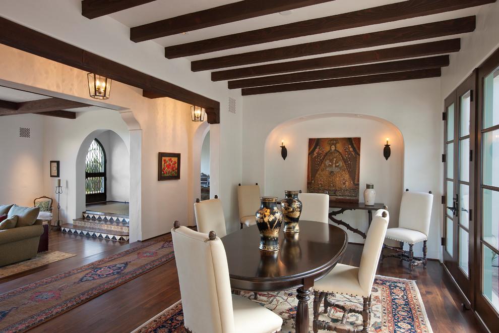 Tuscan dining room photo in Santa Barbara with white walls
