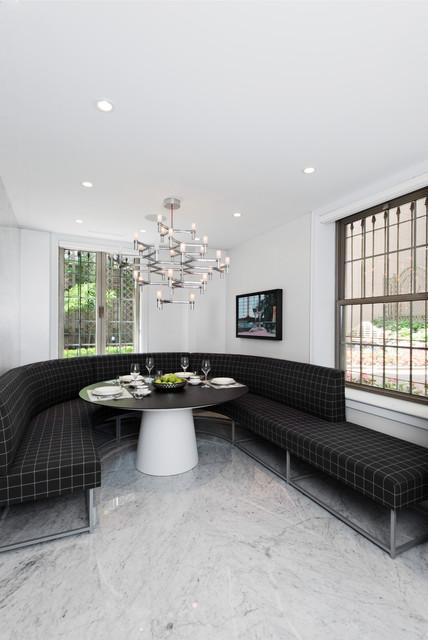 Foto di una sala da pranzo contemporanea con pareti bianche