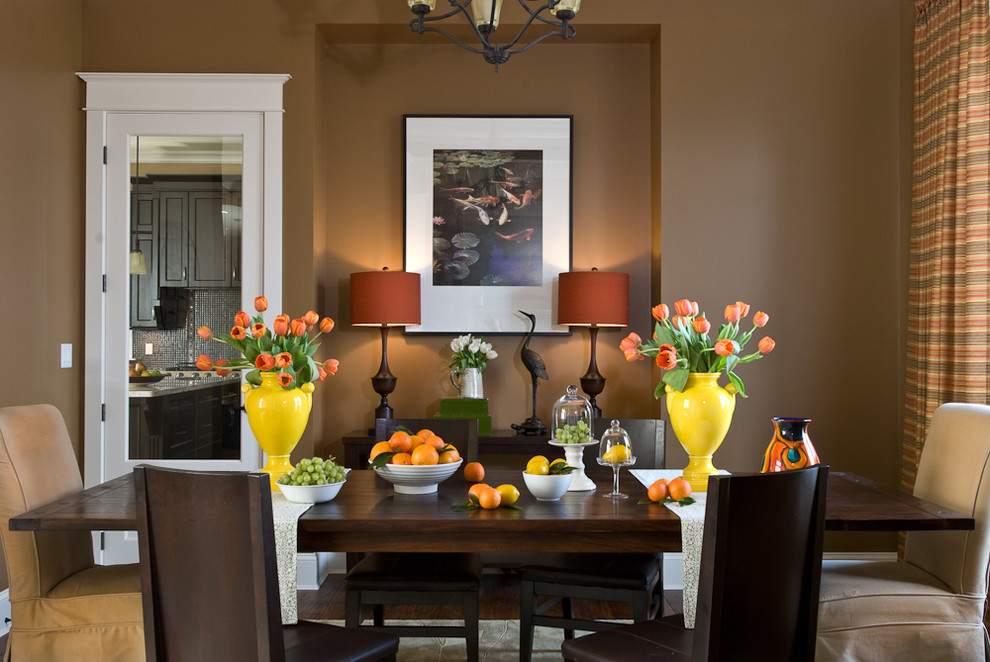 Example of a trendy dining room design in Vancouver with brown walls