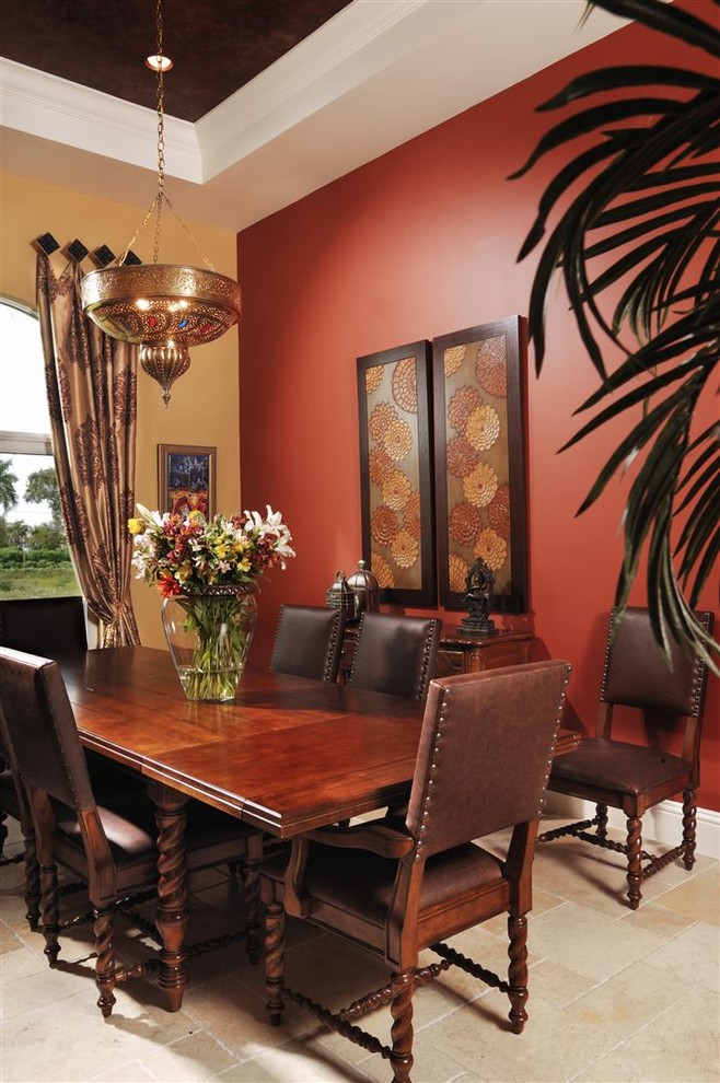 Inspiration for a mediterranean dining room remodel in Miami with red walls