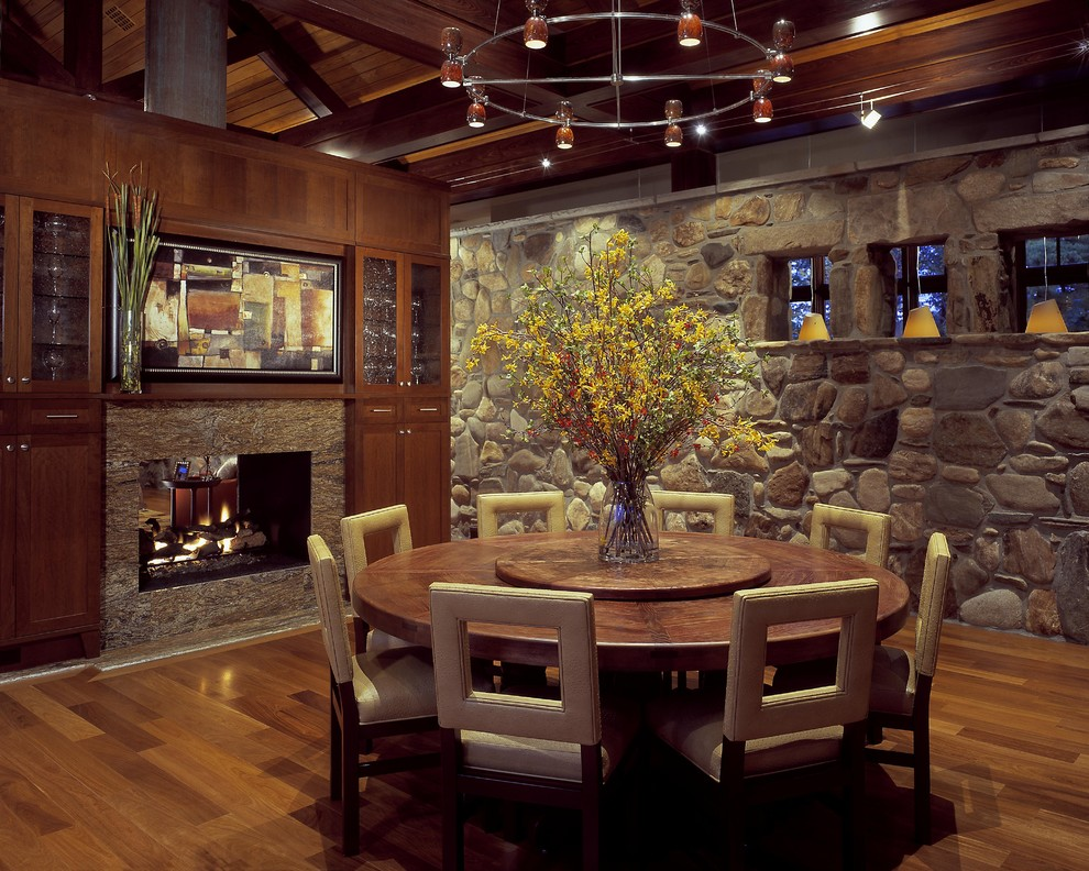 Dining room - rustic dining room idea in Charleston with a two-sided fireplace