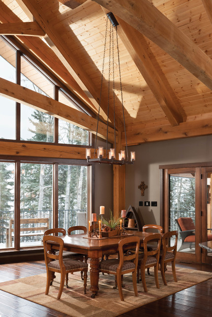 Mountain timber frame home in canada rustic dining for Rustic timber frame homes