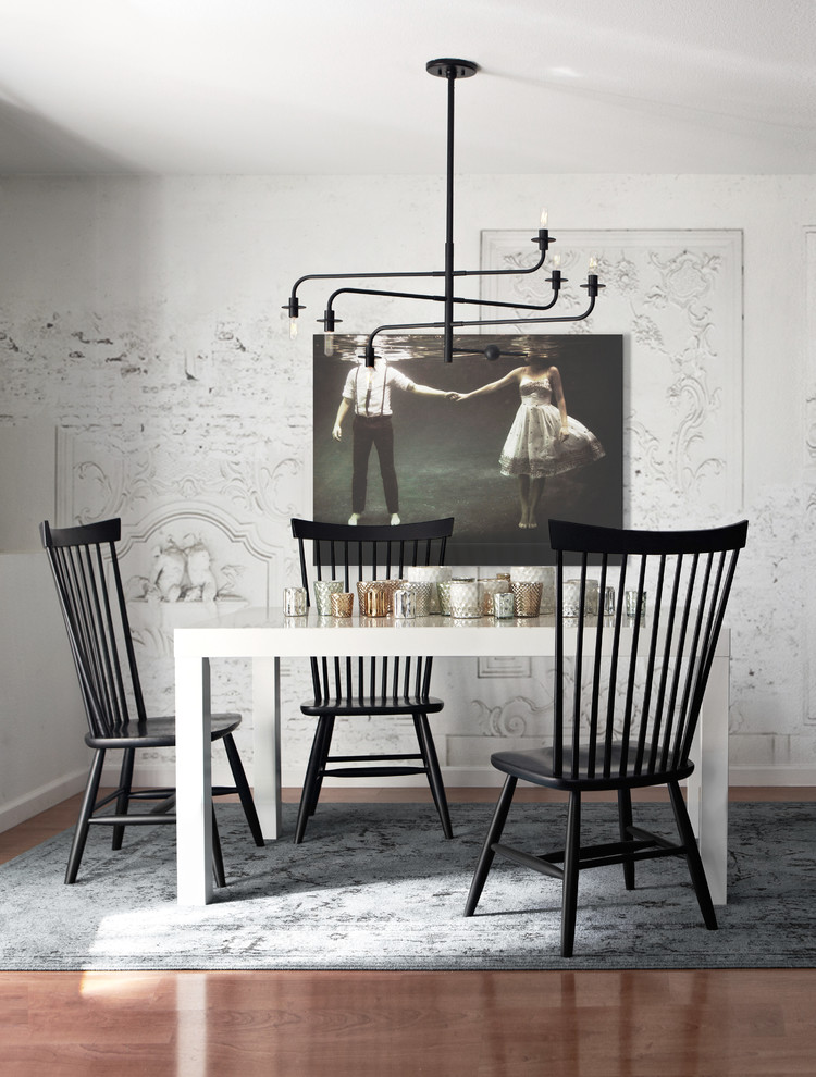 Example of a danish dark wood floor dining room design in San Francisco with white walls