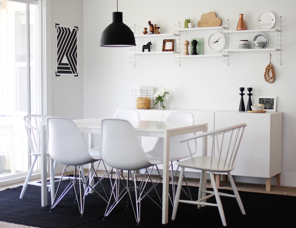 Example of a danish carpeted dining room design in Other with white walls