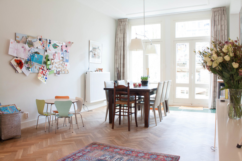 Kitchen/dining room combo - large scandinavian medium tone wood floor kitchen/dining room combo idea in Amsterdam with white walls and no fireplace