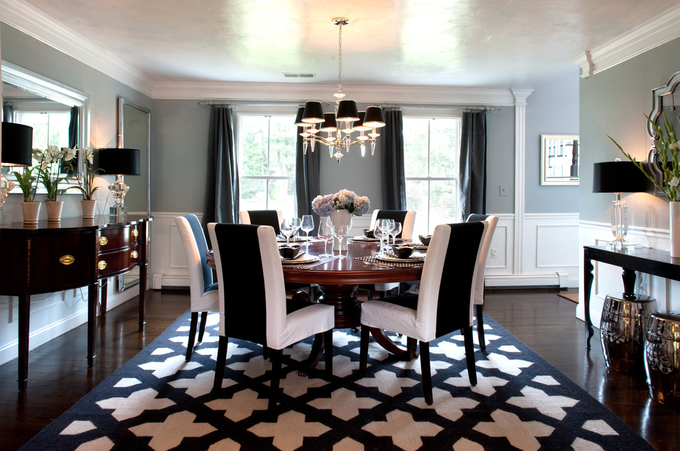 Example of a classic dining room design in Boston with gray walls