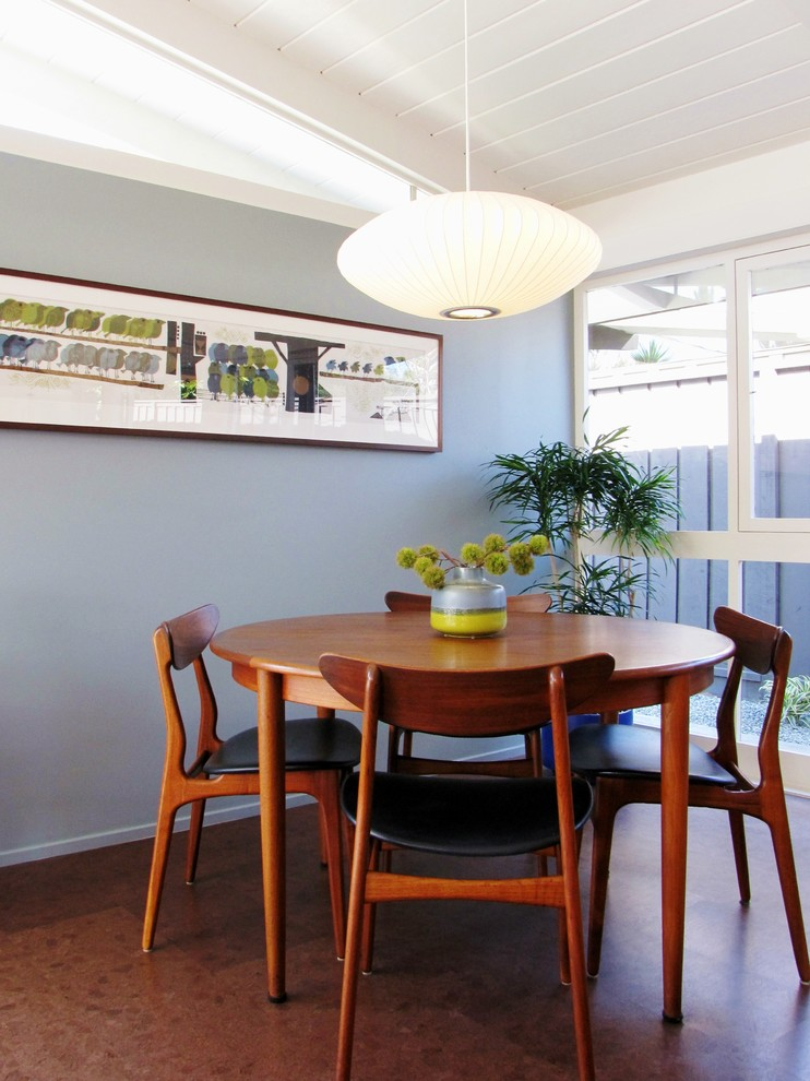 Inspiration for a 1950s dining room remodel in Orange County with gray walls