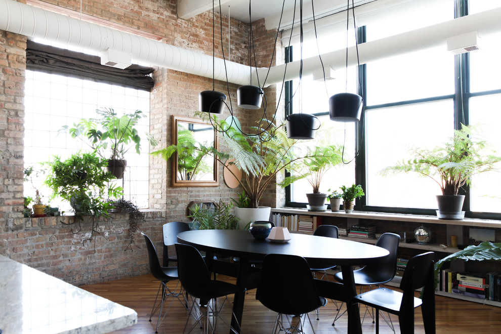 Inspiration for an industrial dining room remodel in Chicago