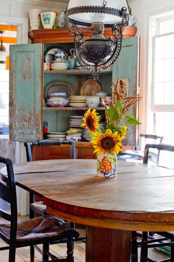 Example of a cottage chic dining room design in New York