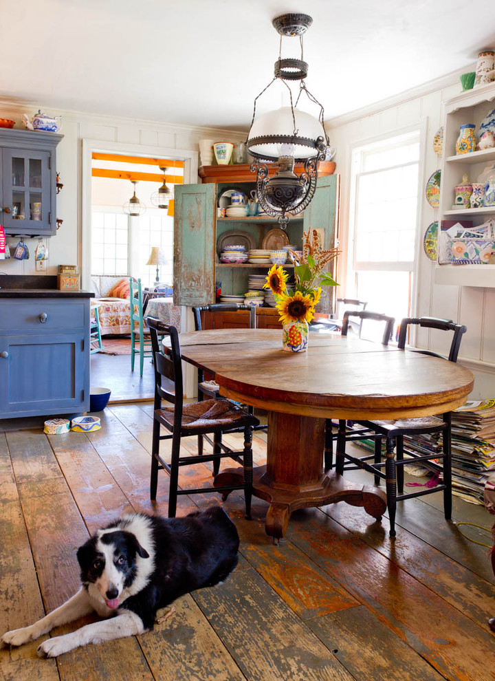 Inspiration for a cottage dark wood floor and brown floor kitchen/dining room combo remodel in New York with white walls