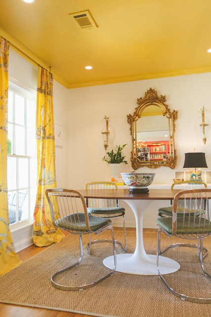 Example of an eclectic dining room design in Austin