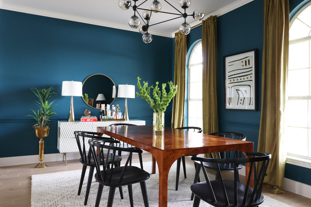 Inspiration for a transitional beige floor and light wood floor dining room remodel in Austin with blue walls