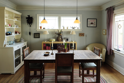 Converted downstairs bedroom becomes a dining room (Eclectic Dining Room by  Portland Media and Bloggers Julie Smith)