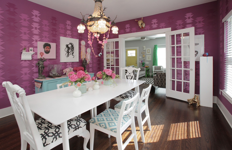 Dining room - eclectic dark wood floor dining room idea in Dallas with pink walls