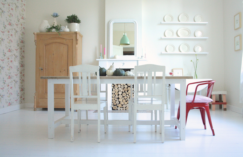 Dining room - shabby-chic style white floor dining room idea in Amsterdam with white walls