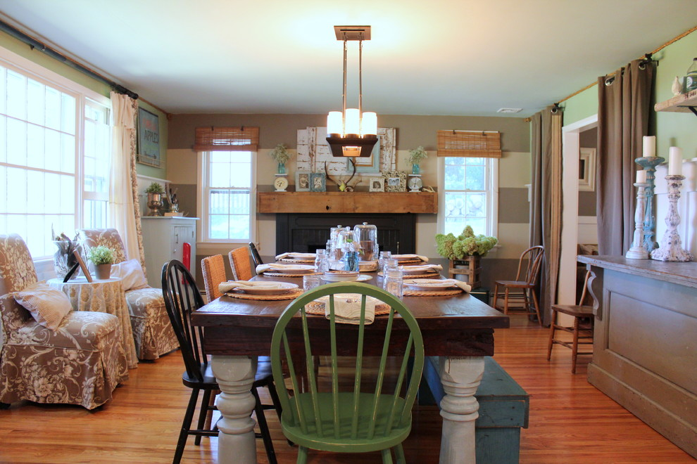 Inspiration for a farmhouse medium tone wood floor dining room remodel in Philadelphia with multicolored walls