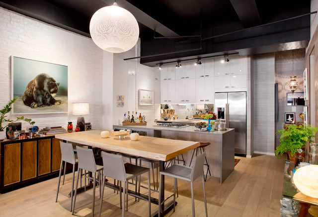 Inspiration for a contemporary light wood floor kitchen/dining room combo remodel in New York with white walls