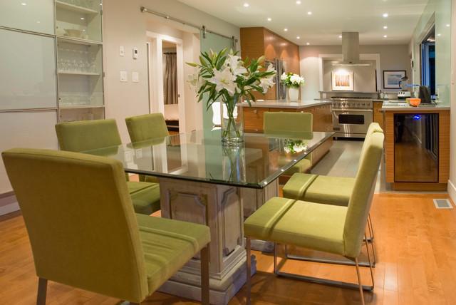 Trendy medium tone wood floor kitchen/dining room combo photo in Vancouver with beige walls