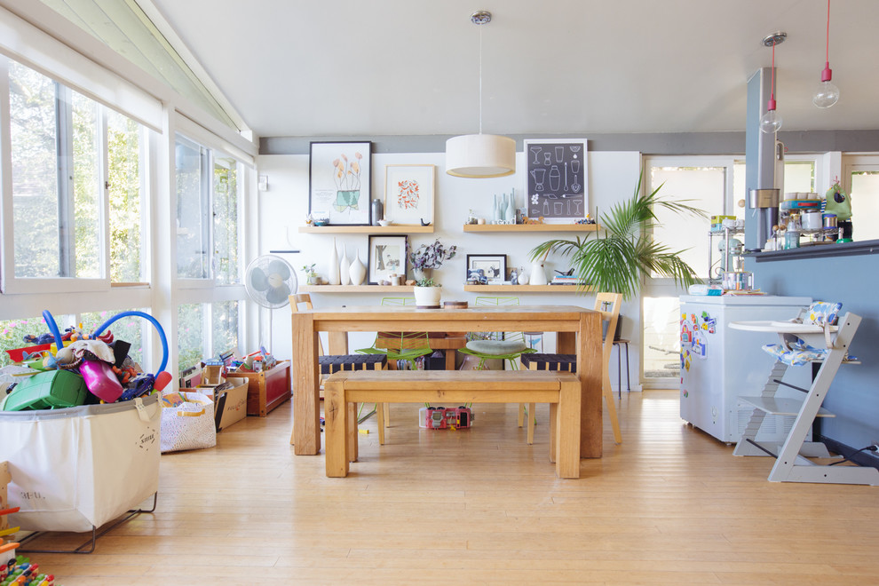 Inspiration for a 1950s light wood floor great room remodel in San Francisco with white walls