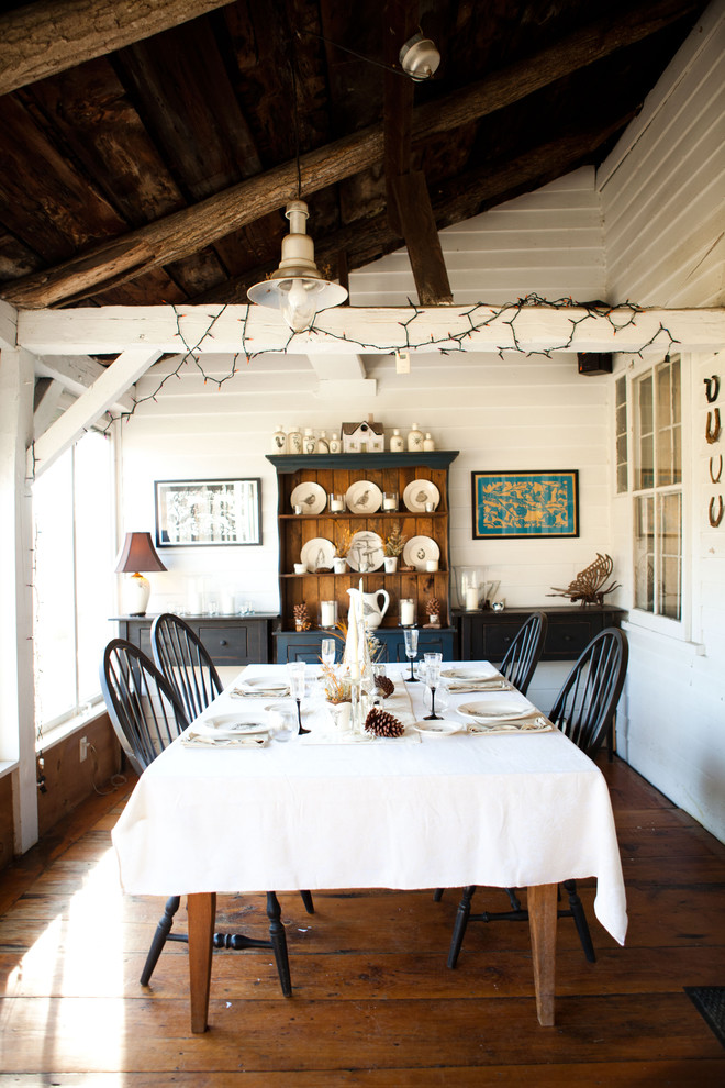Inspiration for a cottage dark wood floor dining room remodel in Burlington with white walls