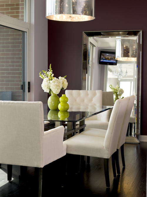 The beveled frame adds a unique dimension to the space and the mirror  brings chic and elegance to the room. Delightful Mirrors in the Dining Room