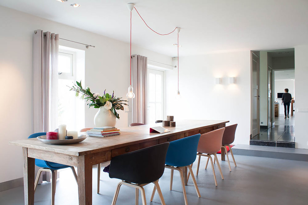 Contemporary dining room in Amsterdam with white walls.