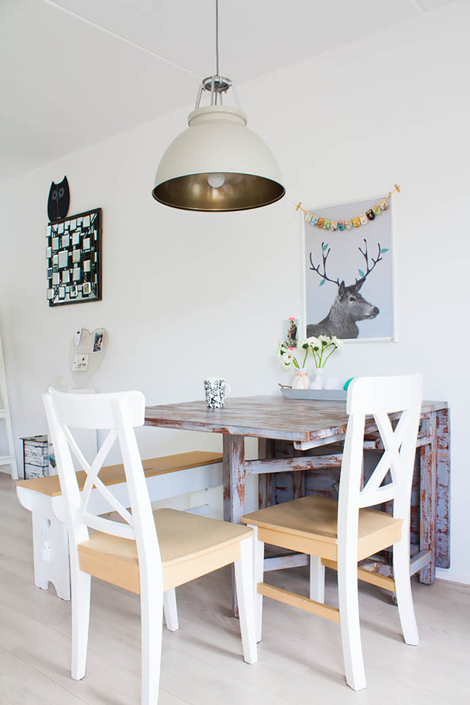 Danish dining room photo in Amsterdam with white walls