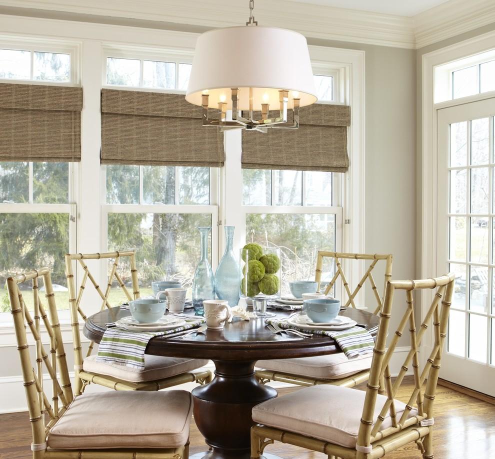 Beach style medium tone wood floor dining room photo in New York with gray walls