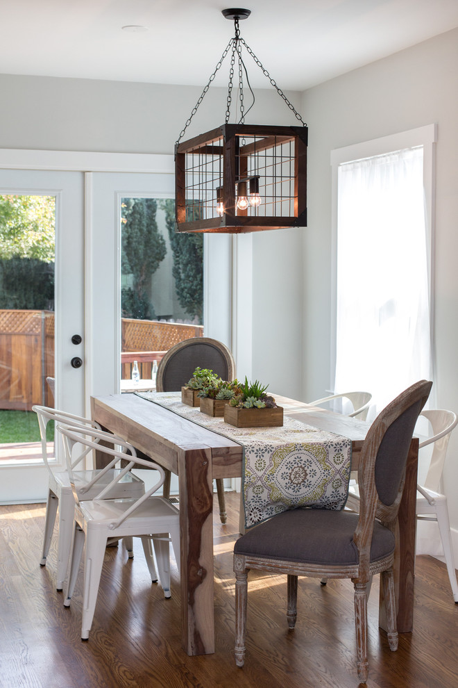 Inspiration for a small country medium tone wood floor and brown floor kitchen/dining room combo remodel in San Francisco with gray walls