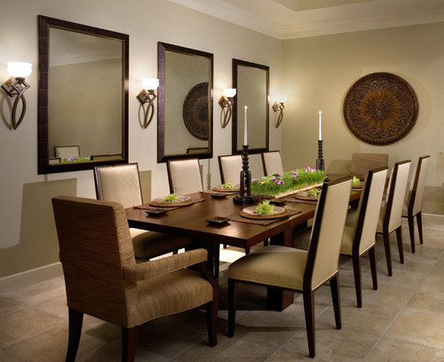 another take on having multiple mirrors in the room is the design above the designer hung three big mirrors along the wall in decorating remember odd - Decorate Dining Room