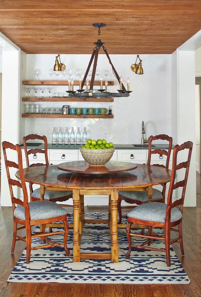 Dining room - mid-sized southwestern medium tone wood floor dining room idea in Atlanta with white walls