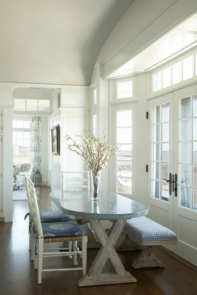 Dining room - coastal dark wood floor dining room idea in New York with white walls