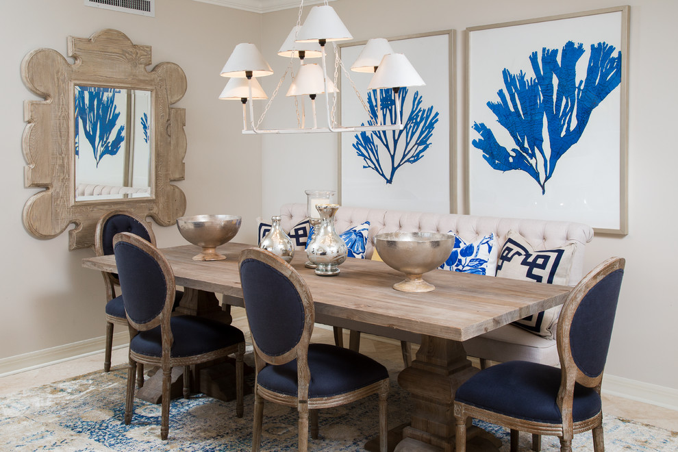 Dining room - mid-sized coastal travertine floor dining room idea in Tampa with beige walls