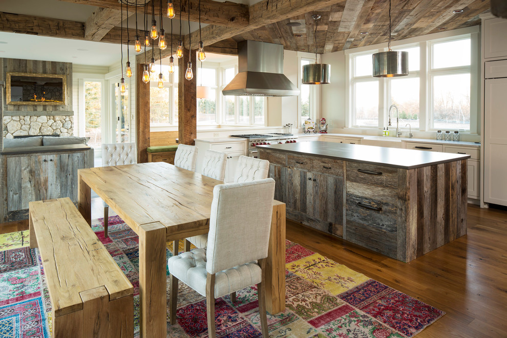 Inspiration for a mid-sized country light wood floor kitchen/dining room combo remodel in Minneapolis with beige walls and no fireplace