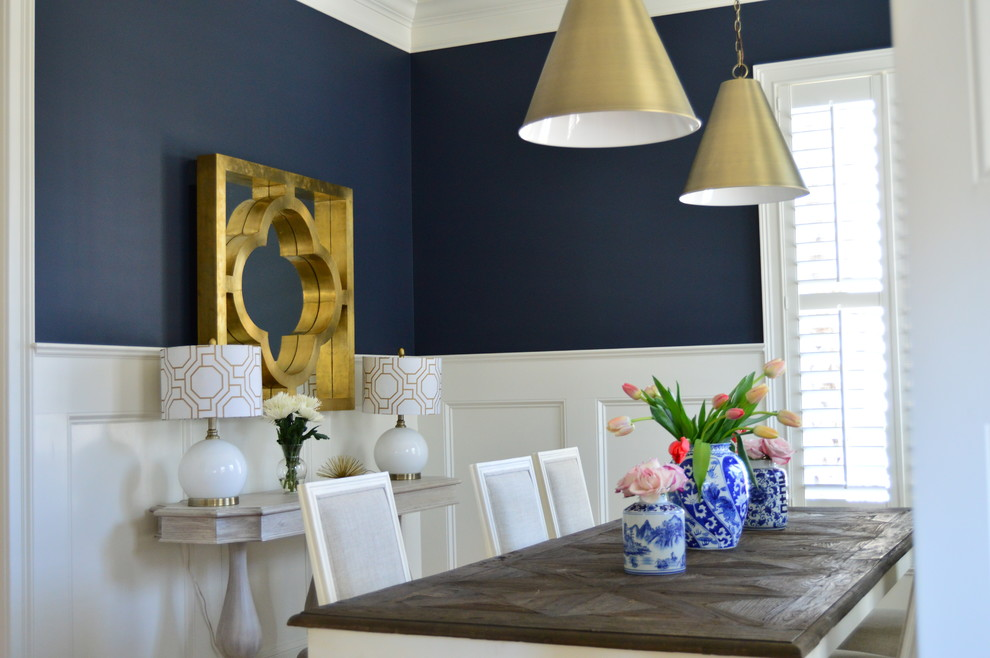 Dining room - mid-sized contemporary medium tone wood floor dining room idea in Charleston with blue walls and no fireplace