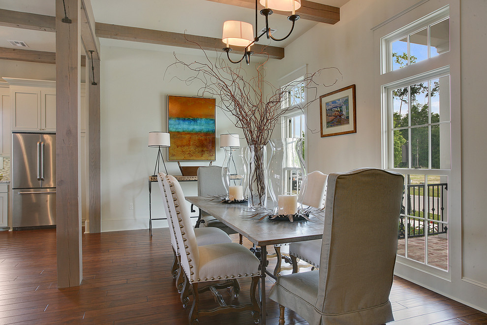 Kitchen/dining room combo - mid-sized traditional dark wood floor kitchen/dining room combo idea in New Orleans with white walls and no fireplace