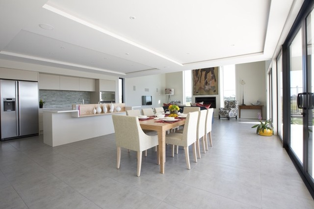 New York Cemento Tiled Kitchen & Dining Area - 3 Lombardia Way, Karaka contemporary-dining-room