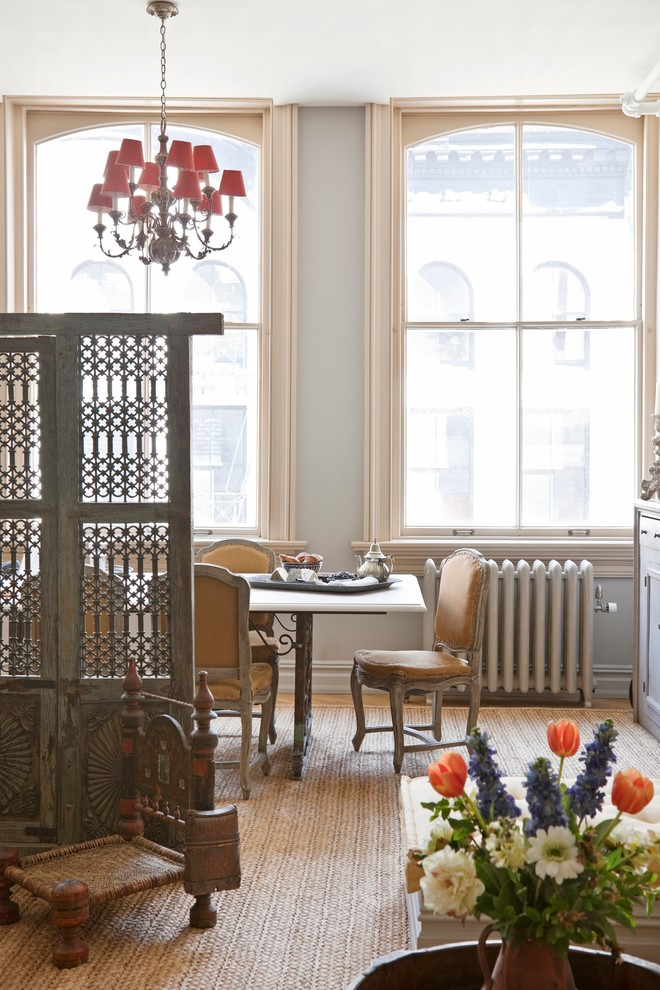 Inspiration for a victorian dining room remodel in New York with gray walls
