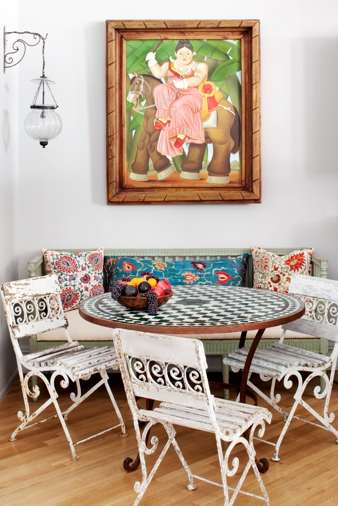 Inspiration for a country medium tone wood floor dining room remodel in New York with white walls